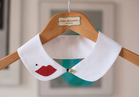 White cotton Peter Pan collar with mouth shaped red patch, black Swarovski bead and golden shank button