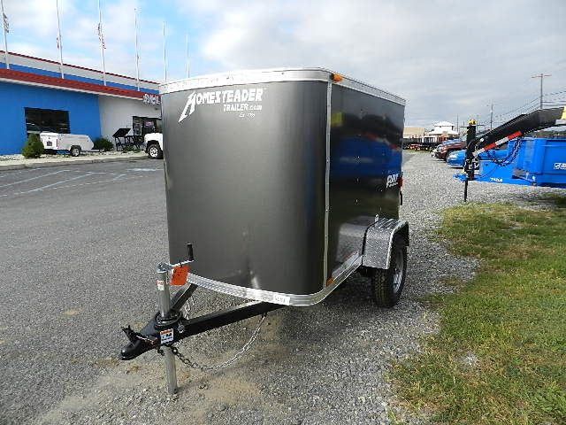 """Interior Deck 44""""W x 74""""L, Rear Door 38""""W x 43""""T, Interior Height 48"""", Tires 175/80/D13, Exterior Height 69"""", Dome Light, 2000lb Axle, Single rear barn door trailer with plywood walls. This small enclosed trailer is a perfect luggage trailer to tow behind"""