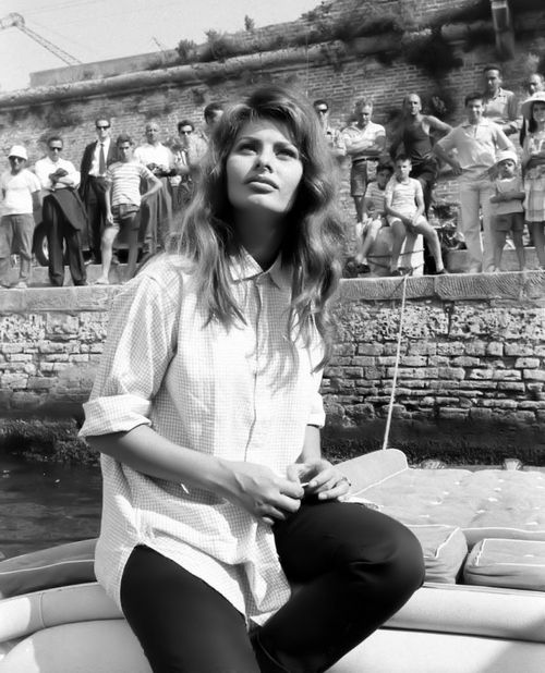 Sofia Loren in a boyfriend shirt. Throw this loose-fitting piece over skinny black pants. Shop and be inspired here: http://rstyle.me/n/q7wqsbgbrf