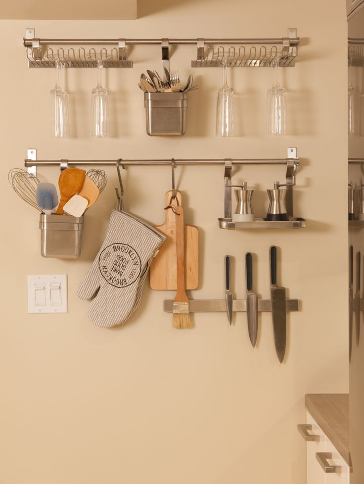 Hang kitchen accessories on the wall to maximize space Maximize kitchen storage