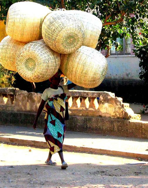 Africa   Woman bringing baskets to the Market. Angola.   © Nate Miller