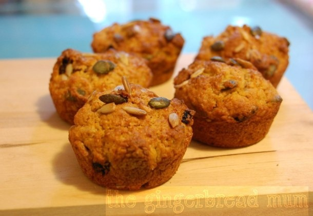 Spiced carrot muffins - low-sugar with plenty of healthy carrot, pumpkin and sunflower seeds, sweet raisins and some wholemeal flour. An easy recipe for even toddlers to help make.