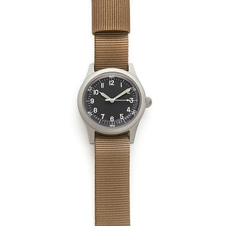An accurate replica of the A-11, a World War II era issued military watch. One of the first military watches to be equipped with a sweep second hand. Brushed steel casing, 17 Jewel mechanical hand wound movement, water resistant, self-luminous hands.