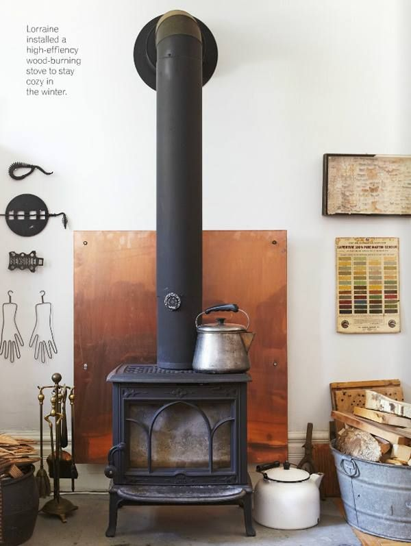 Lorraine's living room and stove. Covet Garden issue 39, November 2013. Photography by Valerie Wilcox www.covetgarden.com