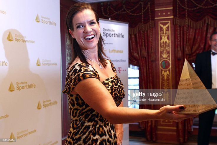 Katarina Witt poses with the Goldene Sportpyramide Award at the Adlon Hotel on May 14, 2010 in Berlin, Germany.