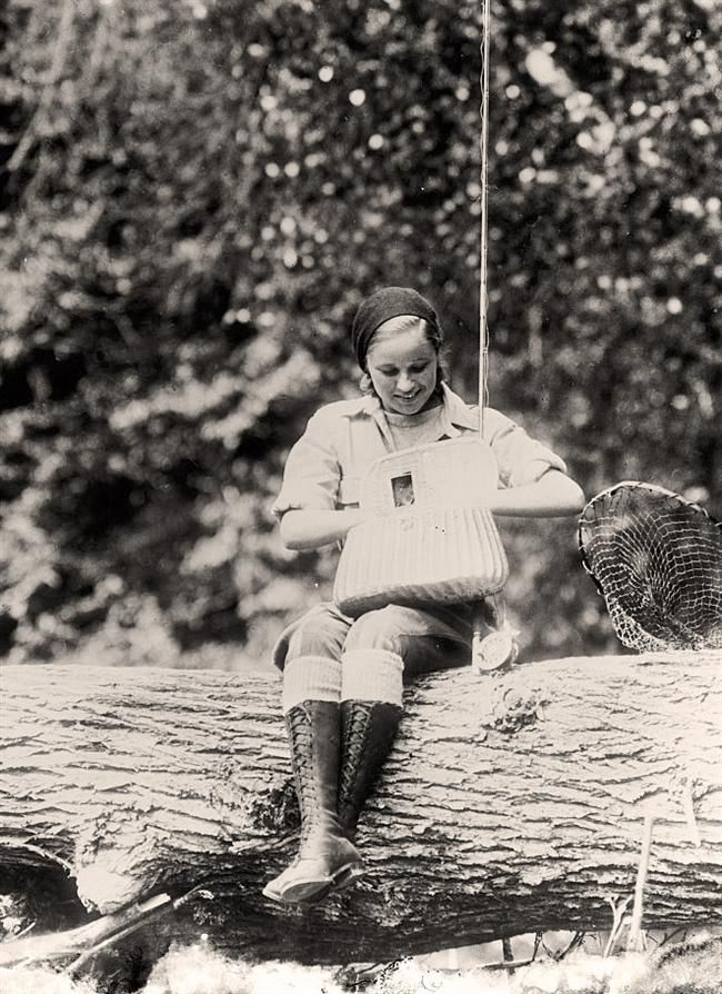 You are looking at an historic photo of Girl Fishing in Maine. It was taken between 1905 and 1945 by Harris & Ewing.