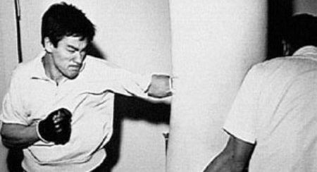 Bruce Lee doing some bag work. doubleaardvarkmedia.com