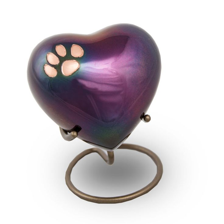 - This raku pet paw print heart keepsake is perfect to keep a small amount of ashes of your beloved pet. - Beautiful tribute to a loving cat or dog. - Add ashes by unscrewing the cap on the back of th