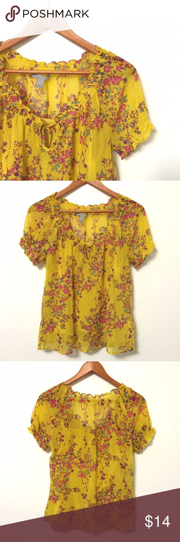 Sheer Floral Mustard Blouse with Cami A beautiful array of bright glowers pop against a golden yellow base. Sheer blouse with elastic smocking at arms and neck and a tie. Comes with a matching cami that attaches at the shoulder. In EUC.     If you have any questions or would like additional pics/measurements I'd be delighted to help. 😊 No PP or trades, please make offers with the offer button. Happy Poshing! Old Navy Tops Blouses