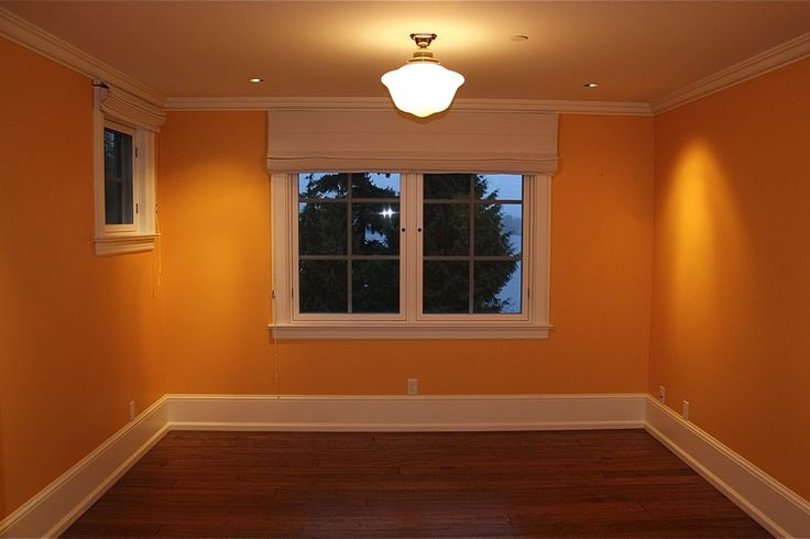 mustard yellow paint color makes this bedroom seem warm and