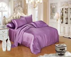 Featuring lovely violet-hued ruching, this feminine luxury duvet cover set adds a touch of texture to your master suite or guest room.