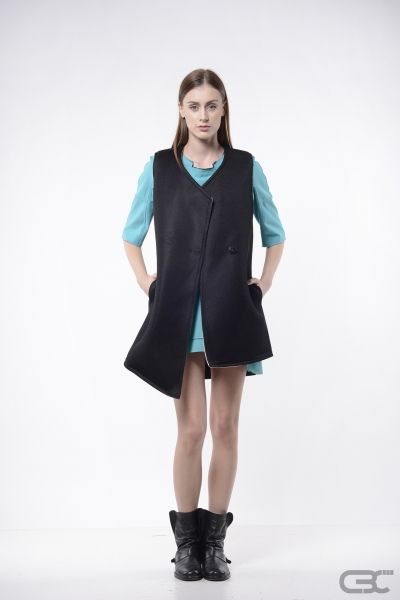 http://cbcdesign.ro/en/shop/vesta-new-planet/  Vest with asymmetric hemline from a tehnical sport fabric. The interior is a metallic silver color.