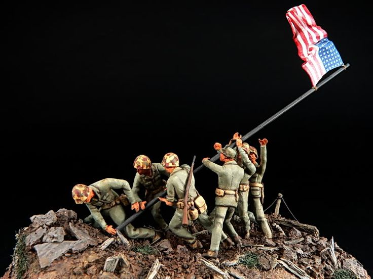 d day men raising flag