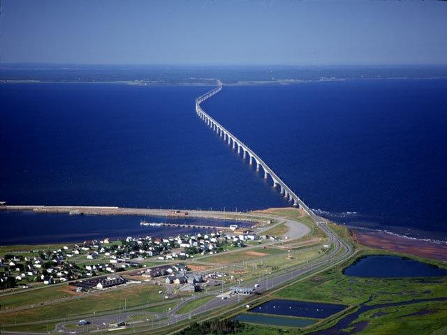 Confederation Bridge goes between N.B. & P.E.I., Canada. the bridge is 12.9-kilometre (8 mi) long, a ten minute crossing at (80 kilometres) 50 mph.