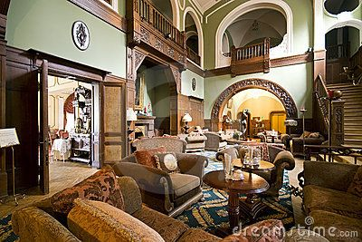 A classic hotel lobby, spacious room, vintage furniture.