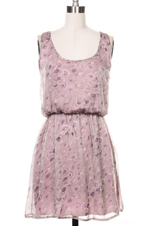 This dress is a little more brown and a little less lilac in person. The delicate feather print and chiffon fabric are so feminine. And check out that bow on the back! Perfect dress to pair with tights for the office!