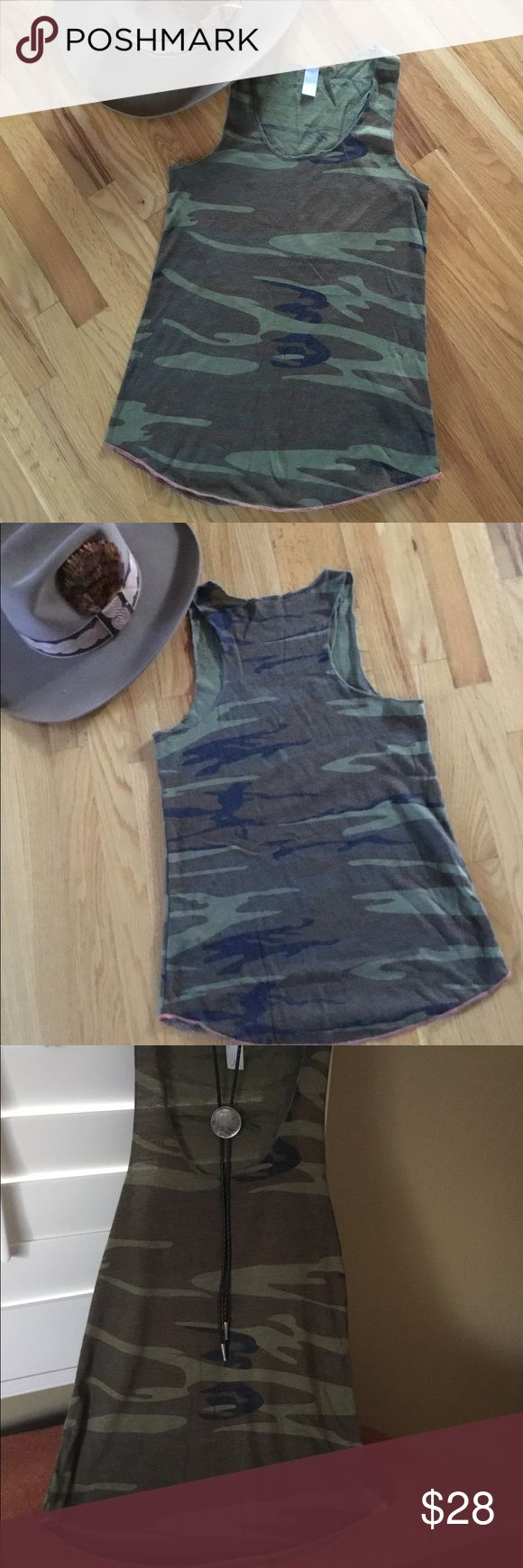Camo Tank Top Very cool camo tank. Wear your black, brown, tan, or white bralette with this adorable tank and you will be turning heads! 50% Poly, 38% Cotton, 12% Rayon makes this an ultra soft tank! New with no tags. Salmon colored trim on bottom. Tops Tank Tops