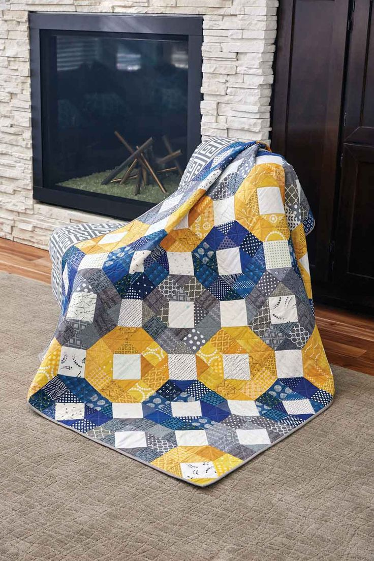 """I'm a Wheel, by Jenn Nevitt, is a good example of """"less is more."""" Simple Four-Patch quilt blocks and Snowball quilt blocks combine to make a bold, graphic design. This throw quilt pattern is a great beginner project and it's a FREE download!"""