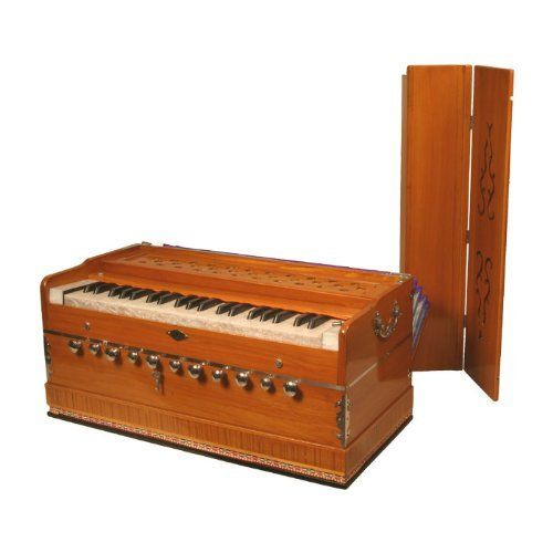 Harmonium, Deluxe, Coupler by banjira. $349.00. 5 drones and 6 stops, play different banks of reeds. Mechanical coupler (plays 2 octaves with one stroke). Fixed keyboard, integral bellows, and dozens of sound combinations. Finish color and decoration style may vary from photo. The Harmoniums are not meant to be played in concert like a mini organ. This is instrument was introduced to India by the British. It has been embraced and is now a truly Indian instrument used as accompan...