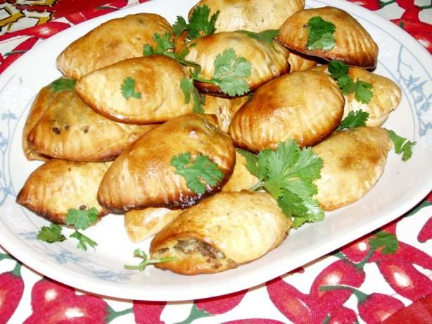 Chilean Empanadas from Food.com: I grew up next to a woman from chile. She would make great empanadas!! This recipe is very close to hers! Very tasty and different! This is an easy recipe in that it uses refrigerated biscuits instead of a homemade dough.