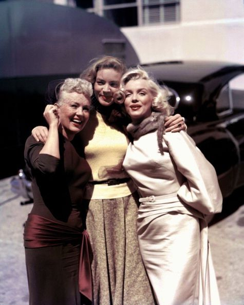 ~Betty Grable, Lauren Bacall and Marilyn Monroe pose for a portrait on the set of the 20th Century-Fox film 'How to Marry a Millionaire' (1953)~