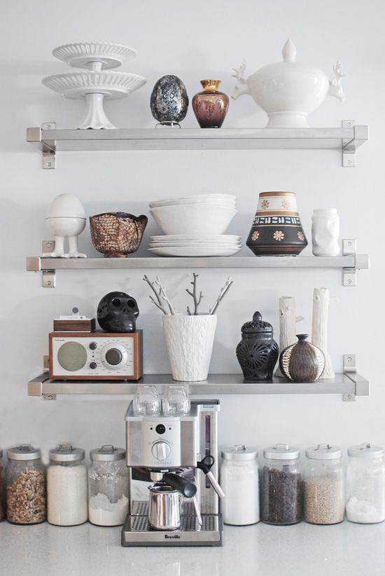 "Even dry goods can be art! I love this ""still life"" of glass storage jars, espresso maker and display items on shelves. So balanced."