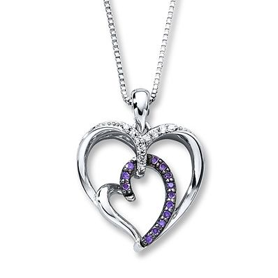 A small heart adorned with Artistry Purple Diamonds® is embraced by a larger heart festooned with white diamonds in this sterling silver necklace for her. The heart pendant is suspended from an 18-inch box chain that is fastened with a lobster clasp. The necklace has a total diamond weight of 1/4 carat. Artistry Purple Diamonds® are treated to permanently create the intense purple color. Diamond Total Carat Weight may range from .23 - .28 carats.