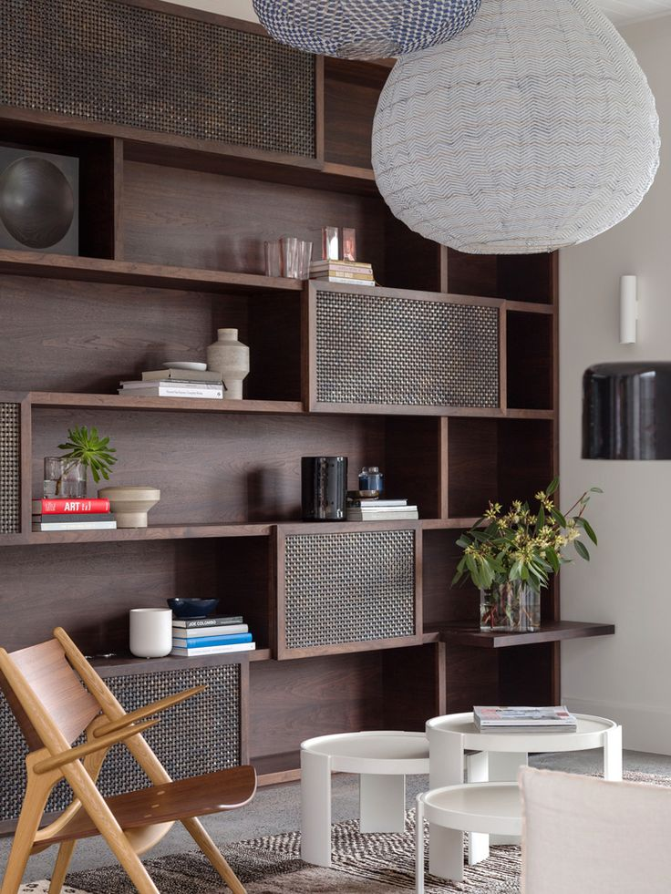 A post-industrial bookshelf provides plenty of storage for the home owners…