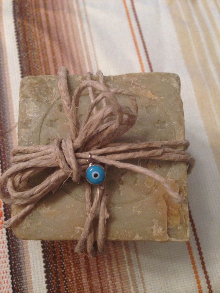 Giveaway for newborn: Lebanese handmade soap wrapped with a raffia ribbon and an evil eye pendant for protection