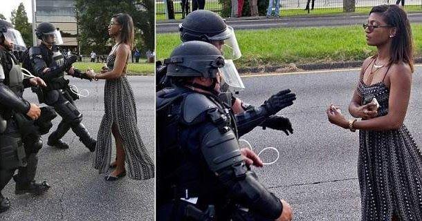 Μια εικόνα, ένα σύμβολο: 28χρονη μαύρη σταματάει τους αστυνομικούς στη Λουιζιάνα [εικόνες]