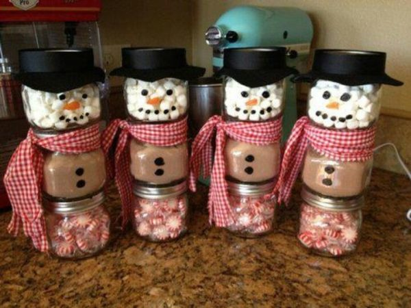 Snow men made from small glass mason jars, or baby food jars, one jar has peppermint, another has cocoa, another has marshmallows, top with black hat and use permanent marker to color on buttons and face.
