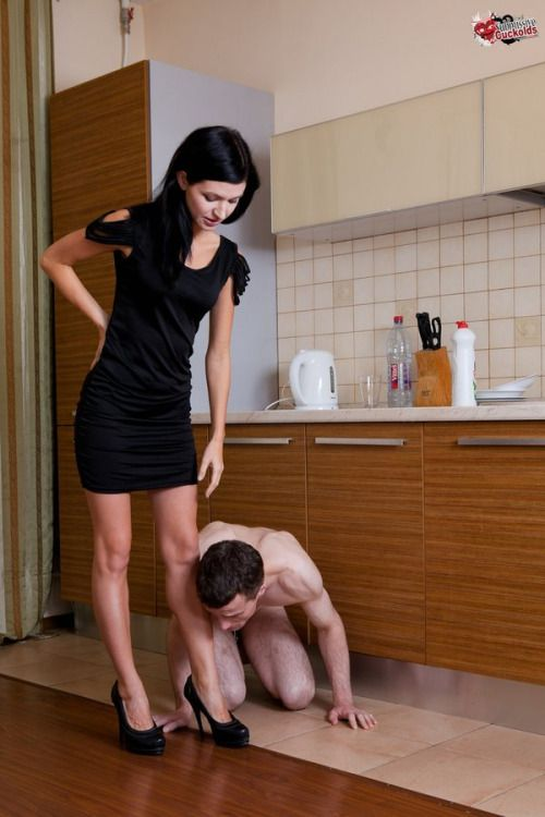 "femdomgames: ""Arriving home you find him greeting you as he should, naked and on his knees. He then proceeds to kiss both your feet before he is allowed to stand up. """