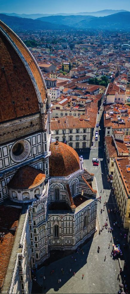 The Duomo ~ Florence city centre and in the distance Tuscany landscape, Italy. For the best of art, food, culture, travel, head to theculturetrip.com