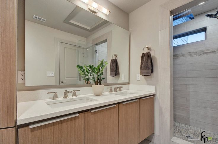 A Marvellous Brown Cabinet For Stylish White Bathroom With Frameless Mirror And Awesome Grey Showering Room The Stylish Design of a Private House : Creative Solutions to the Traditional Environment