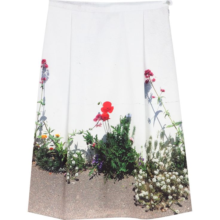 hoëdic skirt stretchy fabric skirt with decorative floral printed hemline. Thin waistband with button and hidden zip side fastening.