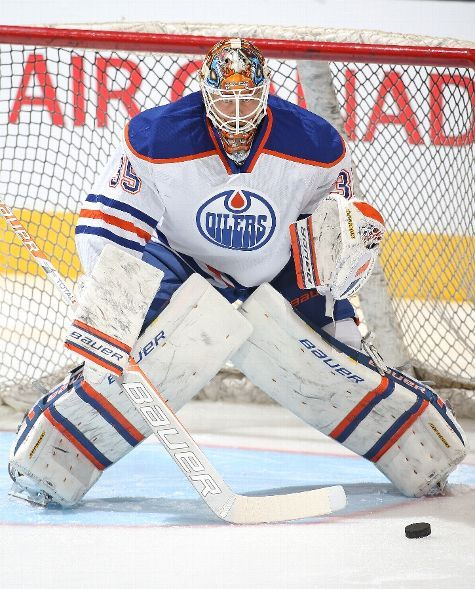 TORONTO, ON - FEBRUARY 7: Viktor Fasth #35 of the Edmonton Oilers faces a shot in the warm-up prior to the game against the Toronto Maple Leafs during an NHL game at the Air Canada Centre on February 7, 2015 in Toronto, Ontario, Canada. (Photo by Claus Andersen/Getty Images)