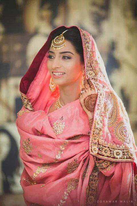 Traditional Indian bride wearing bridal lehenga, jewellery and hairstyle. #IndianBridalMakeup #IndianBridalFashion