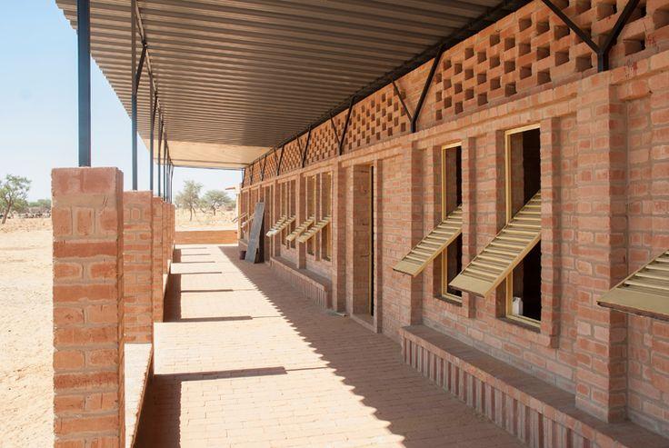 malian school by LEVS architecten constructed with rammed earth blocks