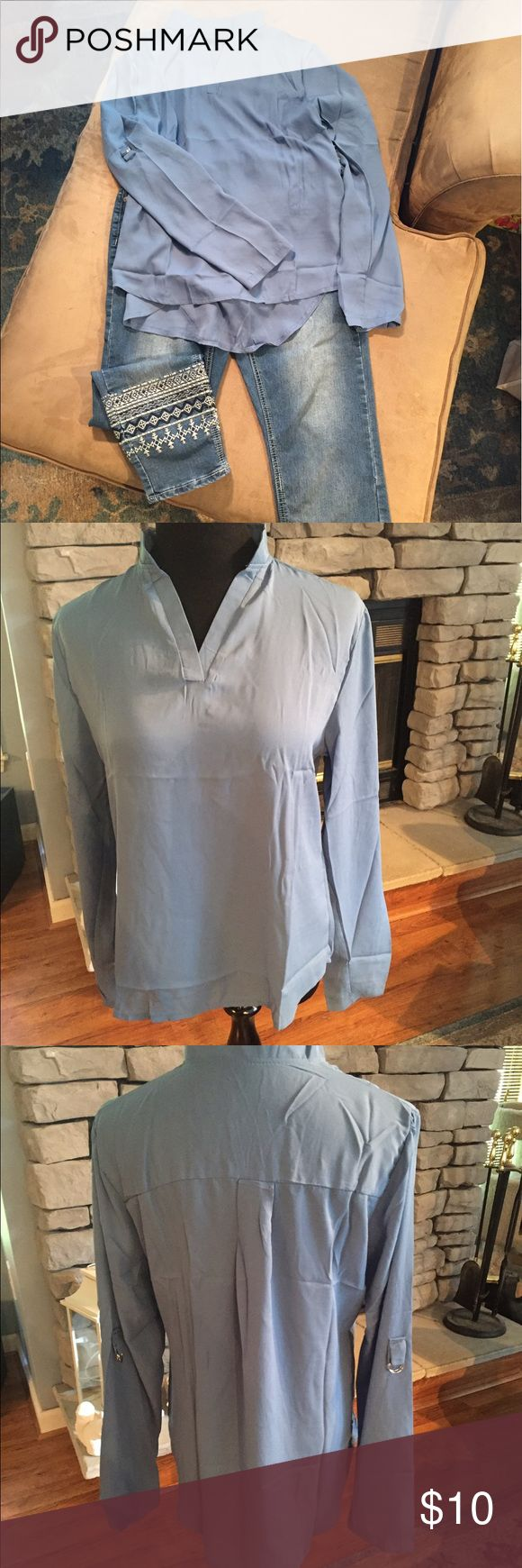"Hi Lo Blouse with Roll Up Sleeves Dress it up or go casual with jeans, this versatile Blouse is super comfortable. Nice, light polyester material. Features double ring loop on side of sleeves to allow for rolling up and staying put. Pretty dusty blue color. Medium measures 36"" bust. Tops Blouses"