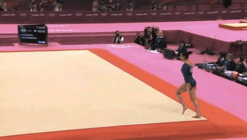<b>A few awesome flips, a little controversy, and one annoyed spectator all add up to a night the American gymnast won