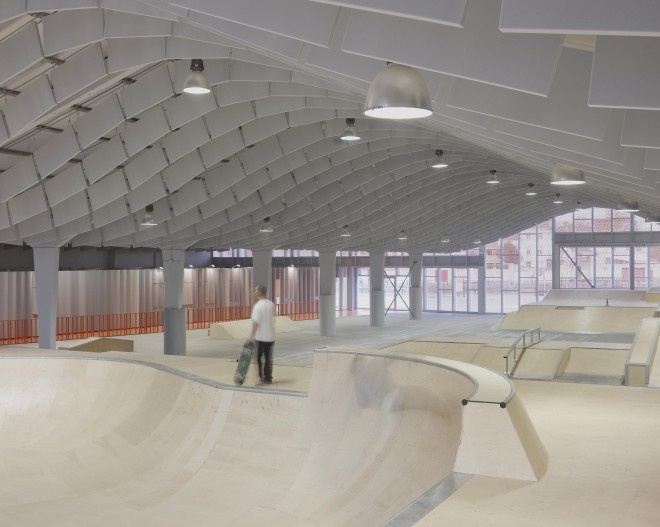 Skatepark Calais BANG architecture. Clever idea to re-purpose an old warehouse and give it a sweeping interior feel using inexpensive suspended acoustical panels.