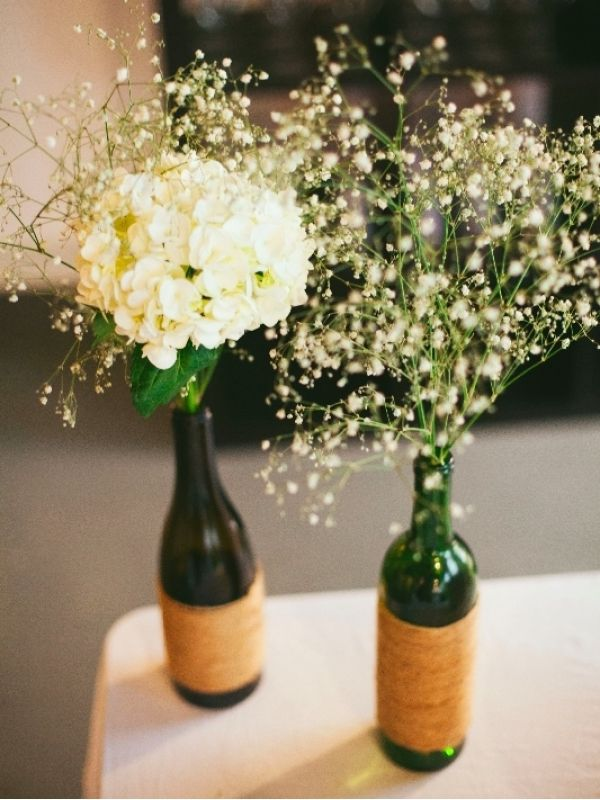 Decorating for your next party doesn't have to be expensive or complicated. For your next outdoor party, check out these easy centerpieces made of upcycled items – plus you can save these for any upcoming wedding reception parties! #DIY #decor