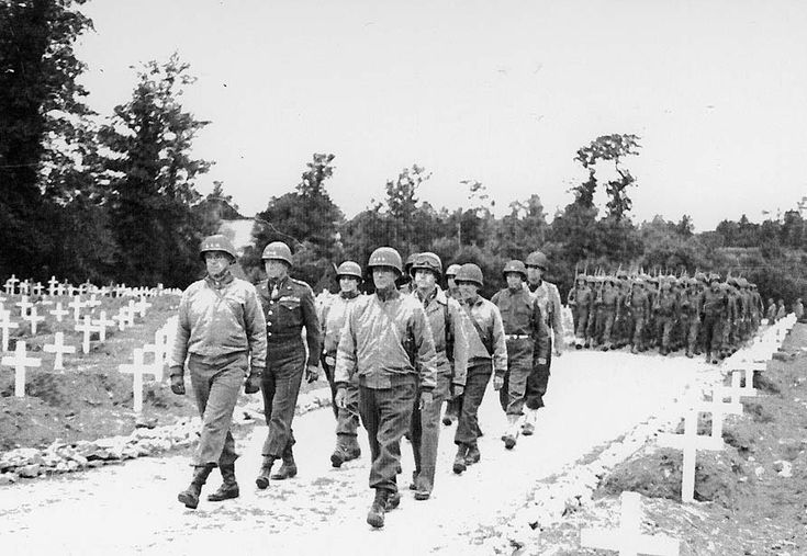 U.S. Army generals lead a procession for the funeral of Gen. Theodore Roosevelt Jr. in Normandy on July 13, 1944. Roosevelt died shortly after D-Day....feb16