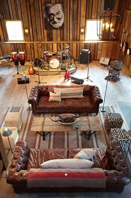 Example of instruments and furniture co existing but likely would go in a bedroom not a living space and up on walls not stands, Man cave