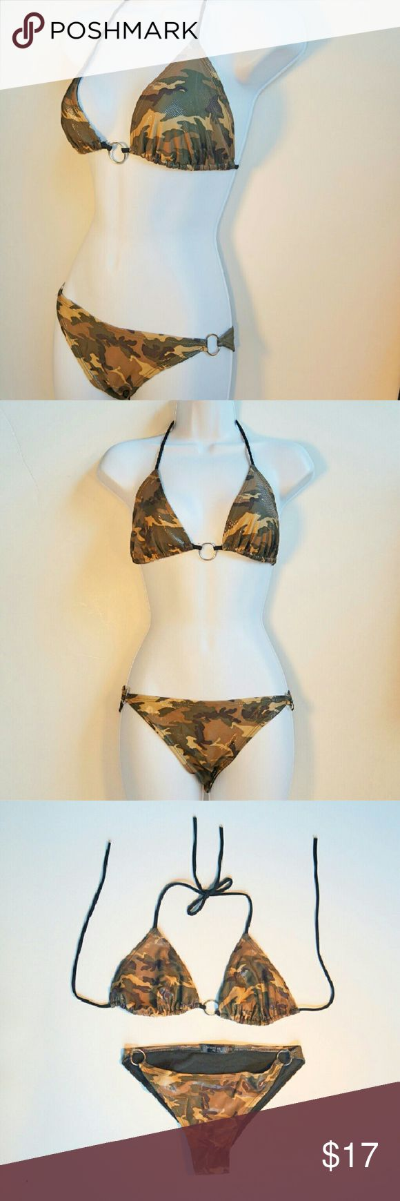Shiny Camo Triangle String Bikini LIKE NEW - WORN ONCE for Halloween Costume   Size tags cut out but Top is M/L (fits C-D Cup) Bottoms are M/L  There is a shiny pattern over the camo design that reflects light and is very eye-catching along with silver rings at hips & chest.  Adjustable triangle top with string ties at neck and back.  Boutique brand Switchblade Stiletto  ✨Made in USA! Switchblade Stiletto  Swim Bikinis