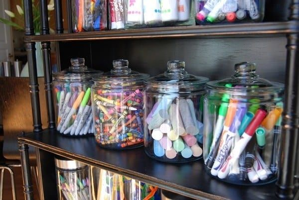 Read more about this art shelf here; get similar jars for $9.99 each here. If you're worried about the glass breaking, try clear plastic candy jars like this one, $6.99.