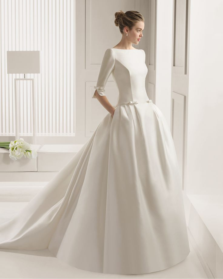 Rosa Clara satin wedding gown with 3/4 sleeves.  Beautiful details