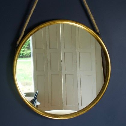 Round Gold Mirror On Hanging Rope.  As long as your mirror has a rope there is hope for reflection and a golden glow around the person you most surely know...