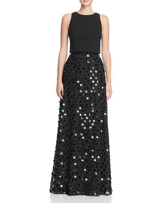 A fun choice for a mom that doesn't usually dress up, the oversized black sequins on this dress will catch the light without stealing the spotlight from your daughter. The casual shape is elevated to formal wear with the floor length and addition of sparkle. | Winter Mother of the Bride Dresses with Sparkles and Sequins