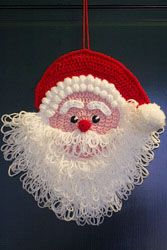 Knitted Christmas decoration Santa Claus at the door (size 28 to 28 cm)